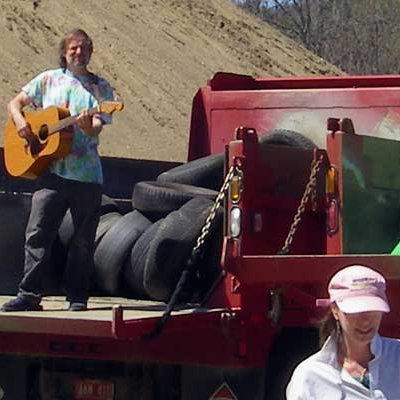 guitar player on garbage truck
