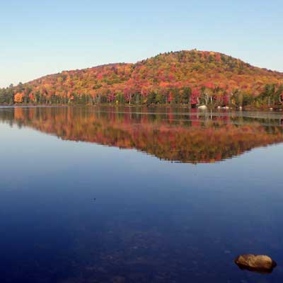 fall color reflected in lake