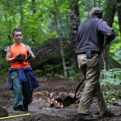 two people work on trail