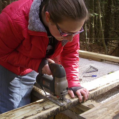 volunteers cuts lumber