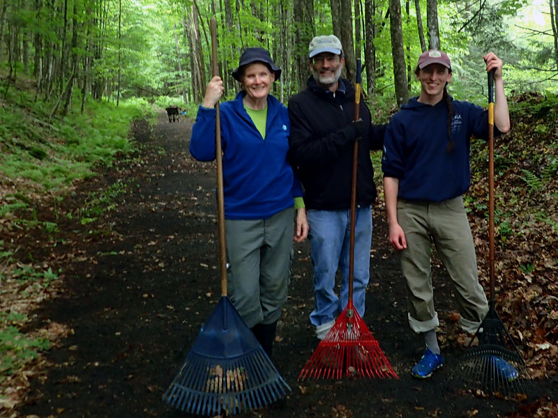 trail volunteers with rakes