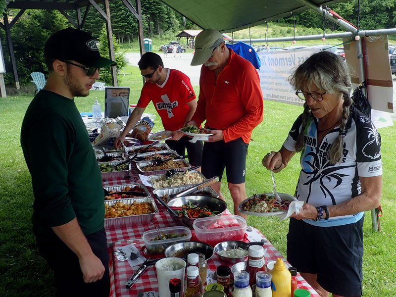 cyclists enjoy lunch buffet
